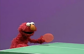 Dorothy is imagining Elmo as twin ping-pong competitors. Elmo's World Balls Tickle Me Land