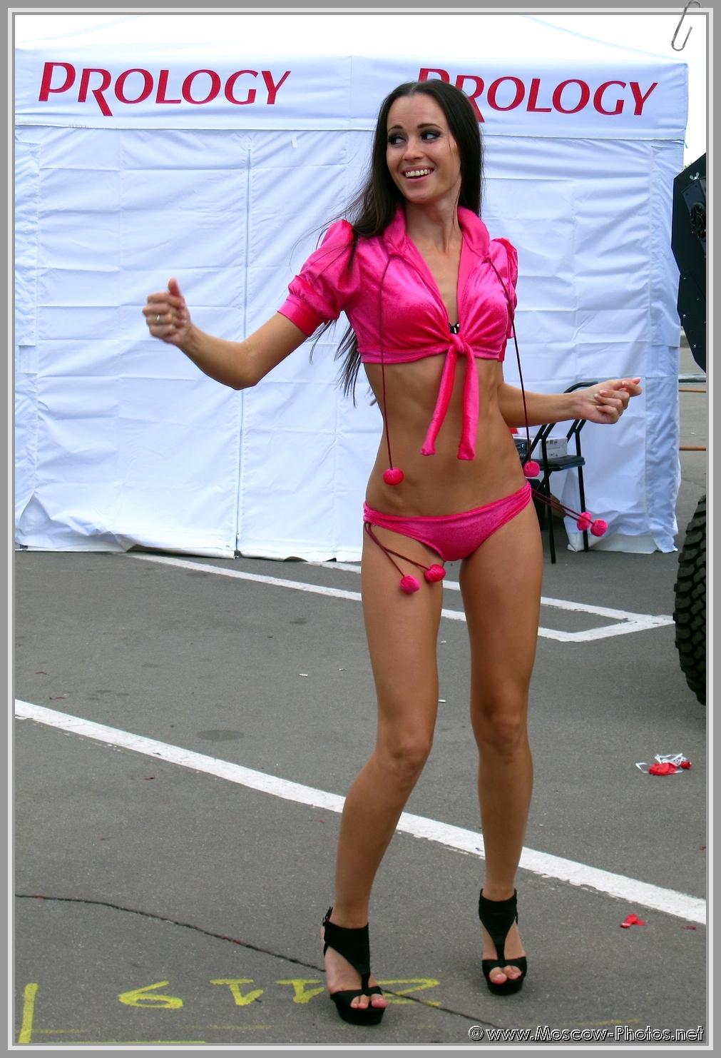 Girl dancing in red bikini