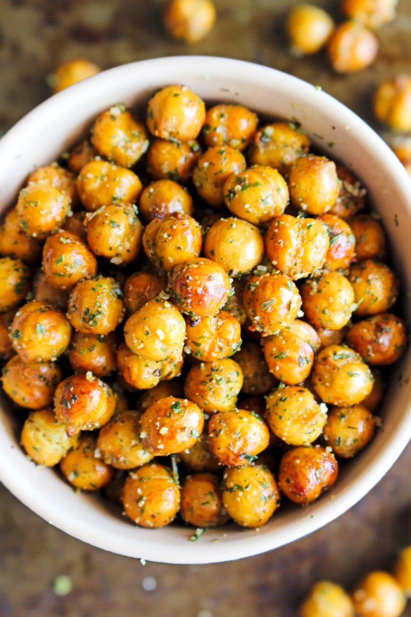 Top view closeup of Crispy Air Fryer Ranch Chickpeas in a bowl on a metal background.