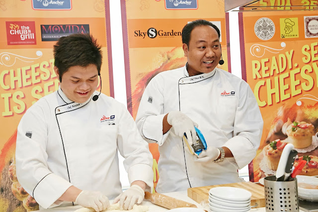 Anchor Food Professionals' Hot Cooking Chef; Chef Alex and Chef Noorfiruz demonstrating the skills needed to create the range of PizzArts during Anchor Food Professionals' PizzArt Campaign launch