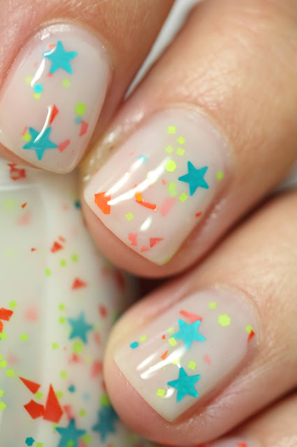 white jelly nail polish with star glitters
