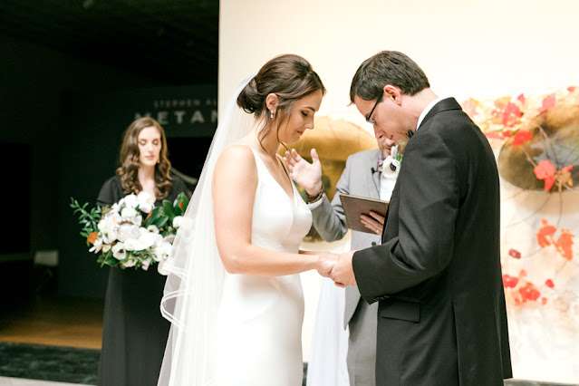 bride and groom praying in ceremony