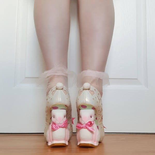 back of flocked bunny heeled shoes with pom pom tail at back