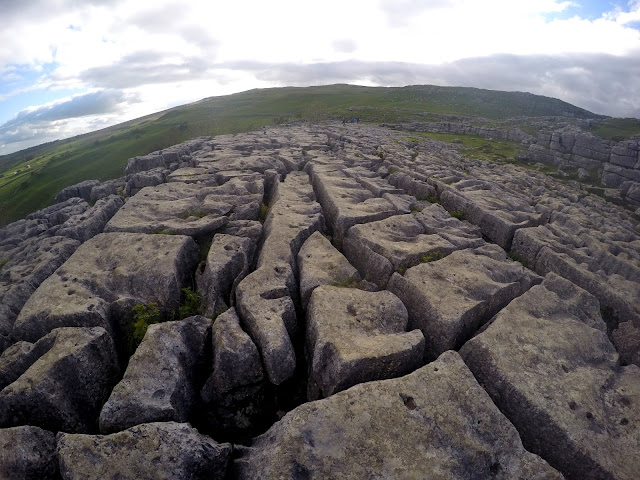 Malham, Malham cove, climbing, sport climbing, limestone, waterfall, Yorkshire, Yorkshire dales, Harry Potter, Deathly Hallows, Adventure, natural beauty, hike, outdoors, Go Pro, Limestone pavement, crack,