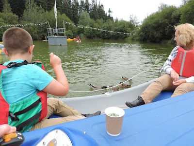 feeding ducks from a boat longleat