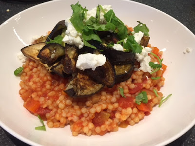 Warm Mediterranean Couscous Salad with Roasted Aubergine and Feta in a white bowl