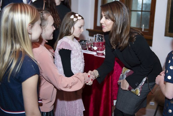 Princess Marie attended Christmas celebrations at Voergaard Castle in Vendsyssel. Giorgio Armani blazer and her Jimmy Choo Glynn boots