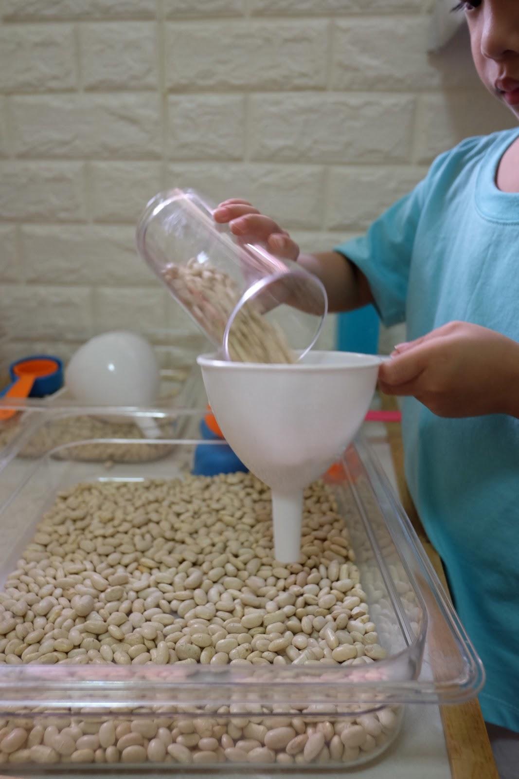 sensory bin scoop pour beans