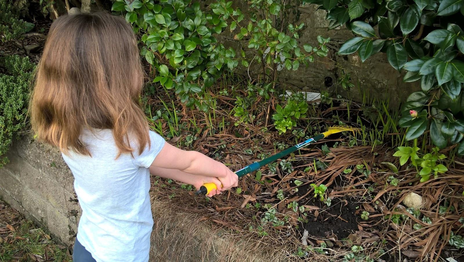 Caitlin Hobbis raking leaves in the garden - Surcare Help A Hand Challenge - motherdistracted.co.uk
