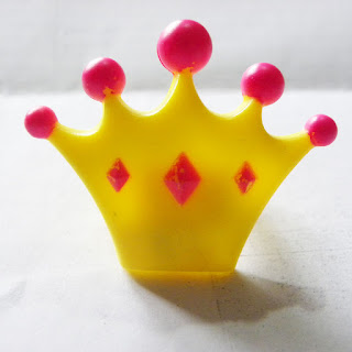 Yellow and pink crown ring from a Greggs cupcake