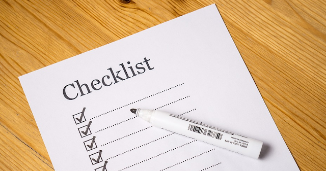 A checklist with some tick boxes and a pen
