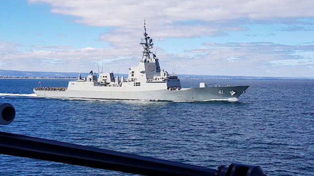 Image Attribute: NUSHIP Brisbane at sea during builders trials viewed from her sister ship, HMAS Hobart / Source: Royal Australia Navy (RAN)