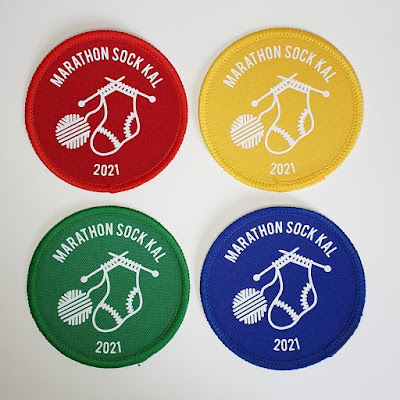 Four cloth patches featuring a sock on knitting needles leading to a ball of yarn and the slogan Marathon Sock KAL 2021