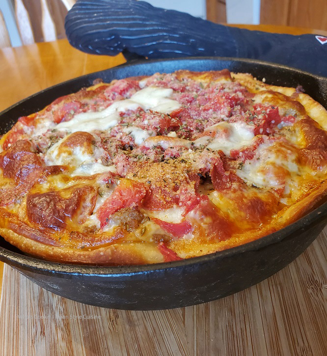 Chicago Style Pizza made in a cast iron 12 inch skillet cooling