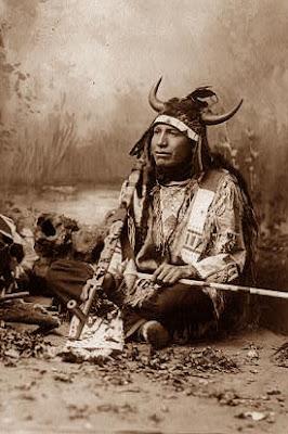 Plains Indian wearing a buffalo horn head-dress