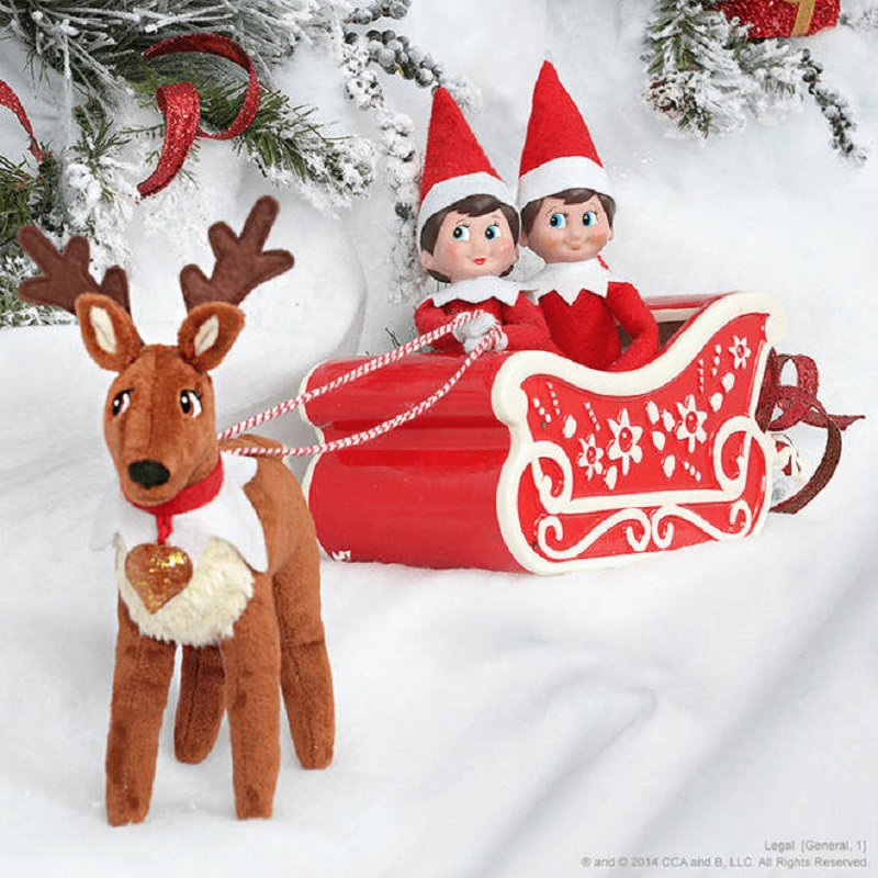 elves arriving in a sleigh with reindeers