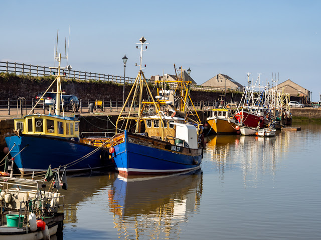 Photo of colourful fishing boats in Maryport Harbour