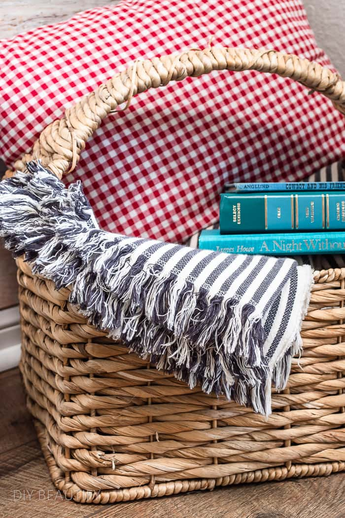 pillow, throw and vintage books in basket
