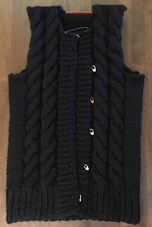 Black jacket knitted with DROPS eskimo