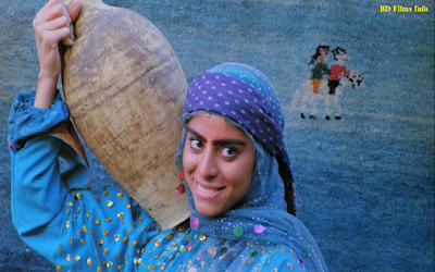 Gabbeh is a colorful romantic Iranian film directed by Mohsen Makhmalbaf in 1996. He is also the screenwriter, editor, set designer and sound editor of the film. As a main female character, Shaghayegh Jowdat has played her role. Besides, it is starred by Abbas Sayyahi, Hossein Moharrami, Roghayyeh Moharrami, Darvaneh Ghalandari and many. At the 70th Academy Awards, the film was selected as the Iranian entry for the best foreign language film, but it was not accepted as a nominee in 1998. The film was banned in Iran for being 'Subversive'.    Plot:  The film gets its name from a kind of Persian rug. Gabbeh is brightfully a colorful, romantic ode to beauty, nature, love and art. It is a documentary style fictional love story film which uses a Gabbeh as a magic storytelling, the story of past and present fantasy and reality. On a bank of a stream, an old woman and her husband are washing their Gabbeh. From this carpet comes forth a beautiful young woman named Gabbeh. Gabbeh shares her epic tale. She is desperately in love with a mysterious horseman who follows her clan from after. Though her father has argued to let her marry with the horseman, season after season, the horseman follows Gabbeh. He is always present always wonting, howling songs of love after nightfall. Her uncle who is hoping to find a bribe and most importantly her longing for a young man, she hopes to marry. At last Gabbeh one day rides on a horse and pulls away with the horseman, her desirable love.    Story:  The screenplay of the film is written by Mohsen Makhmalbaf himself. It's like a documentary film. But it is actually a fiction film. It is Makhmalbaf's creation. In western countries, people are overwhelmed by fiddicult, complicated and rough situations. When they got to the movies they don't want to see the same complexity and violence they are surrounded by. But Gabbeh is naturalistic poetry about love that gives anyone a sense of tranquility. It's a romantic love story of a woman Gabbeh who belongs to a tribal society in Iran. Cinematography:  Mahmud Kalari is the cinematographer of the film. he has worked with a number of renowned Iranian film directors such as Abbas Kiarostami, Jafar Panahi and many. His cinematic style is something different from other Iranian cinematographer. In this film, he uses most of the shots as metaphoric. To know about the cinematography style of the film, we have to know its shots divisions, mise-en-scene and lighting style.    Shots: Most of the scenes are taken as close-up shots to express the expression of the character. But long shots, wide shot, medium shots have been used also normally. There is shot variation in the film. But most of the time the shots are taken as metaphoric. Metaphor is referred to anything that expresses the abstract meaning or allegory meaning of the object.    Mise-en-scene:  The story of the film is about a love story of a nomad in southeastern Iran. It has a natural beauty. It's a colorful life. The arrangement of the scenes and the props refer to a tribe society. Most of the scenes are taken as metaphoric style. It identifies the differences from western countries to Middle East countries. It expresses the culture of the tribal society through the props, norms and activities.    Lighting:  Natural lighting is a must for the movie. It's an outdoor shooting movie. So, there is no use of artificial light in it.    Acting:  Acting is realistic in this movie. It's a documentary style film. It's actually a fictional film or magical film. it is also influenced by realism. Smooth acting, no violence, no sexual desire or no overacting but pure romantic love story are in it. They are the main characteristics of acting in this film. Sound and Music:  Music is composed by Hossein Alizadeh. The music of the film is resembles with the music of the tribal society of the Middle East countries. Music is also very important to think the culture of a tribe. In this film the music has been composed to support the scenes of the film. So the sound is like the realistic one and the scenes have helped too to be attentive the audiences.    Editing:  Mohsen Makhmalbaf has edited the film himself. The storytelling of the film is different and the editing style of him is also different. There is no special effect. It is totally a naturalistic one. There are transitions or effects but there is no special effect. Assembling of the scenes is very artistic. There is shot variations in it So that it looks authentic, aesthetically naturalistic.