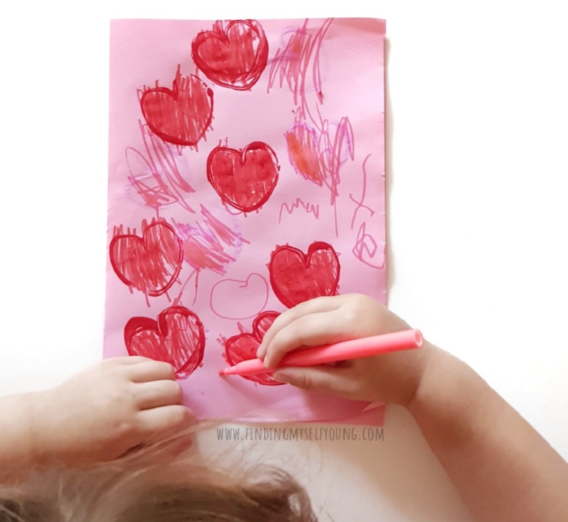 toddler colouring in heart prints