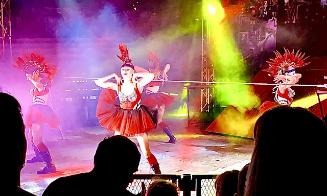 Quick changing dancers entertain between acts at the circus