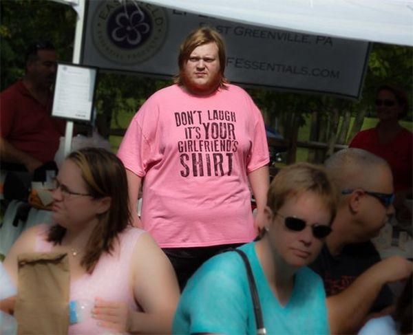 'DON'T LAUGH IT'S YOUR GIRLFRIEND'S SHIRT' pink T-shirt as worn by a fat fuck.