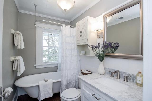 bathroom with original clawfoot tub with craftsman trim on doorways and windows • 24 Massie Avenue, Paris, Kentucky, Sears Norwood model