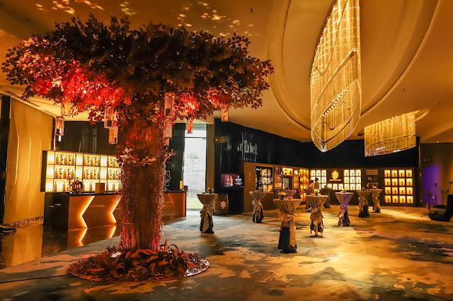 foyer with big tree