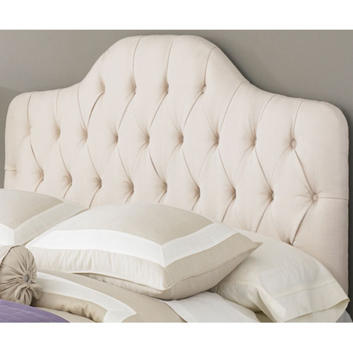 This cream tufted headboard is 60s inspired and looks modern but classic.