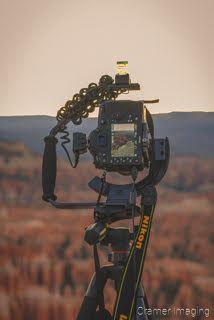 Cramer Imaging's photograph of a camera on a tripod taking a picture at Bryce Canyon National Park Utah at sunrise