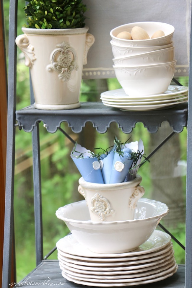 French Country Sunspace almost always includes white French style urns with preserved boxwood