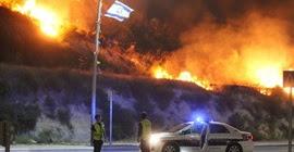 شاهد.. مئات الحرائق في إسرائيل وإجلاء آلاف السكان (فيديو)