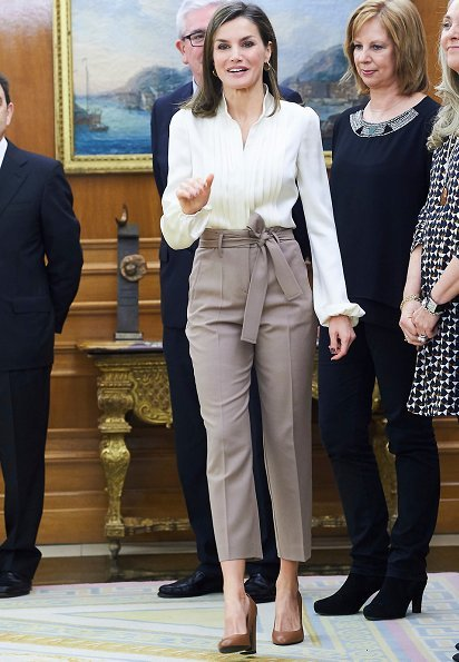 Queen Letizia wore camel Hugo Boss block-heel pumps, silky billow sleeve blouse and Atelier Swarovski Kalix Double Stud Pierced Earrings