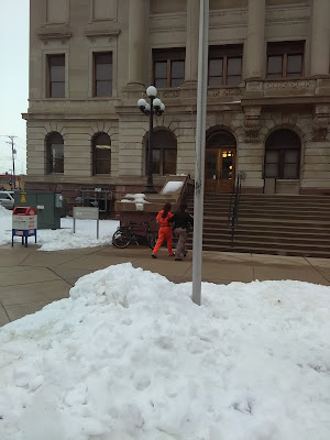 Female inmate being escorted to the Manitowoc county court house