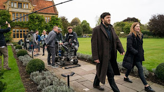 Tom Burke and Holliday Grainger outside behind the scenes filming shot