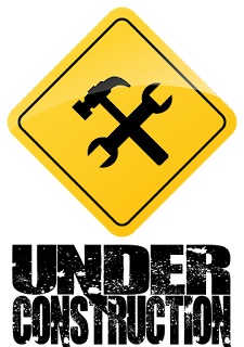 A crossed hammer and wrench on yellow warning sign.  Text underneath reads: Under Construction