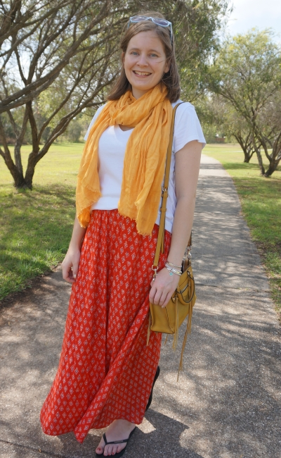 yellow and red maxi skirt outfit with white tee and micro regan bag | away from blue