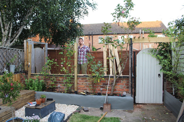 Installing fence posts against low brick walls