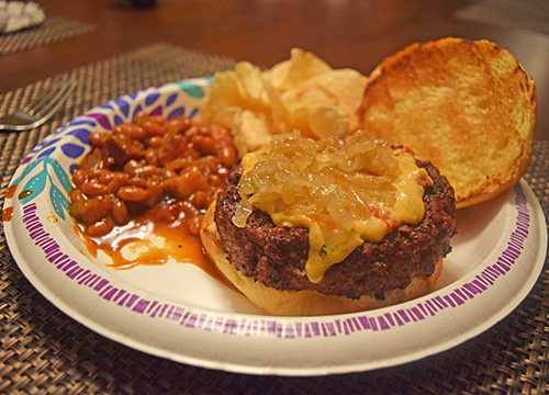 Pimento cheese burger and BBQ beans cooked on a Big Green Egg kamado grill
