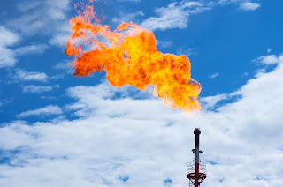 gas flare at petroleum oil refinery
