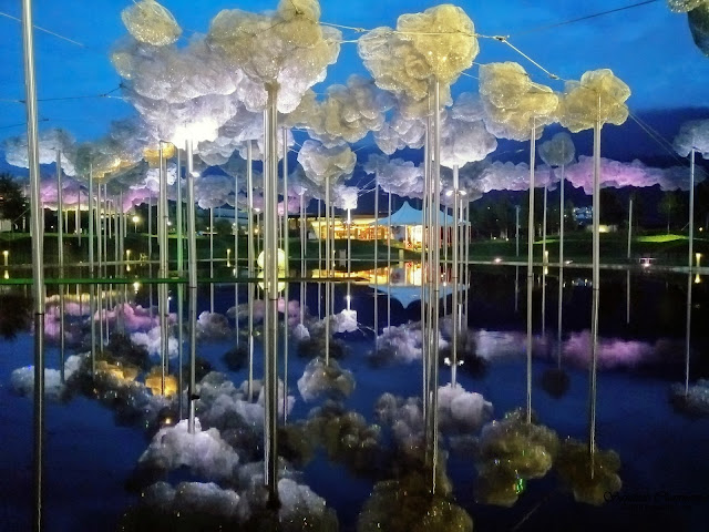 Crystal Cloud above the black Mirror Pool with over 800,000 hand-mounted Swarovski crystals