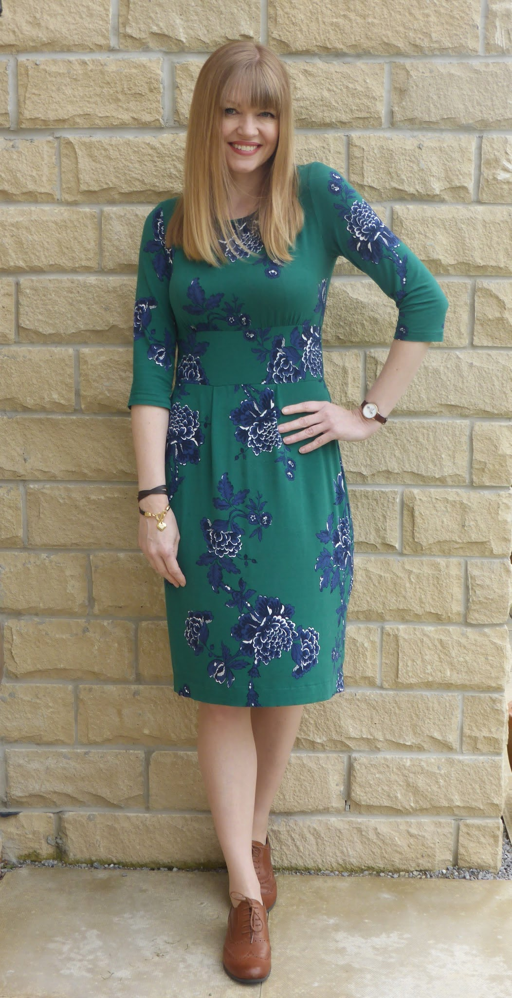 What Lizzy Loves wears a floral dress with tan leather brogues