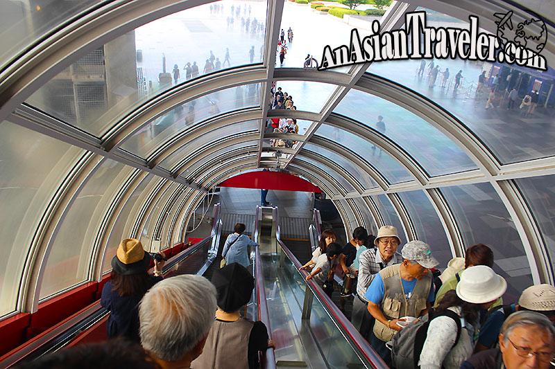 Long tube red escalator
