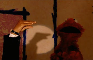 a hand can do a shadow duck or snapping fingers. Sesame Street Elmo's World Hands Interview