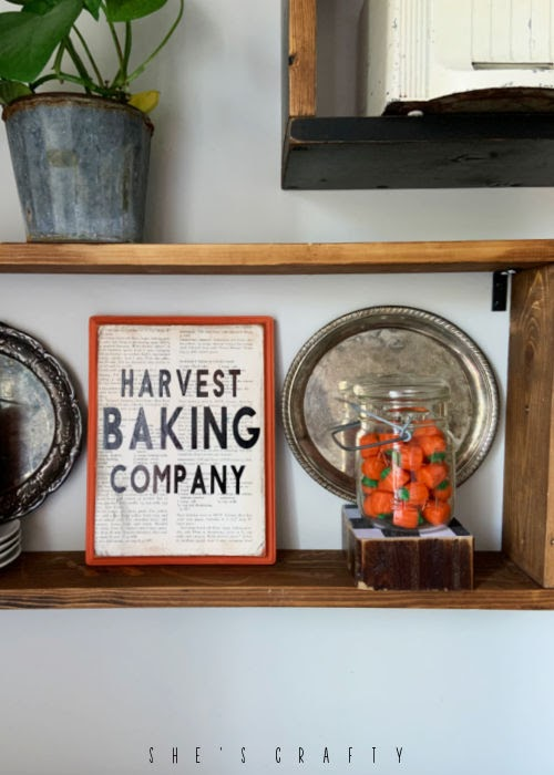 Wooden Shelves with fall home decorations.