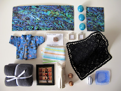 One-twelfth scale miniature paua splashbacks, vases, Hawaiian shirt, frames and crocheted rug.