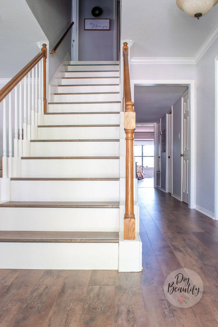 stairs redone with farmhouse laminate floors