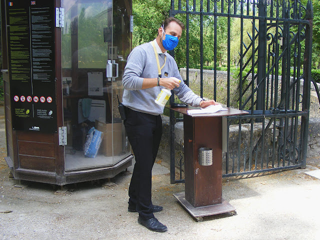 Disinfecting the entrance station at the Chateau of Chenonceau during the Covid19 restrictions.  Indre et Loire, France. Photographed by Susan Walter. Tour the Loire Valley with a classic car and a private guide.
