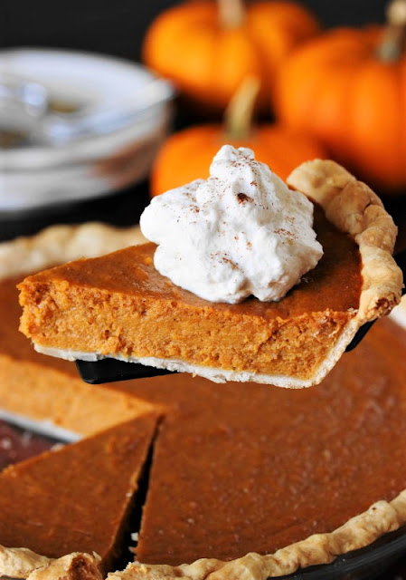 Serving a Piece of Sweet Potato Pumpkin Pie with Whipped Cream Image